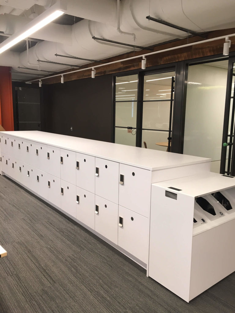 workplace islands with lockers and recycling stations
