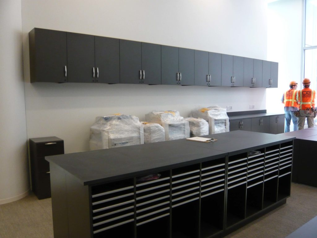 Mailroom furniture, drawers in islands, corporate spaces
