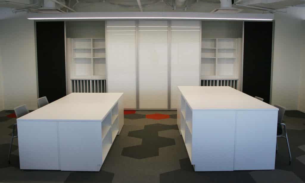 workplace islands, team storage, sliding whiteboards on wall storage